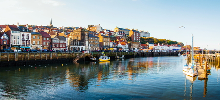 whitby: Scenic view of Whitby city in autumn sunny day.Whitbys attraction as a tourist destination is enhanced by its association with the world famous horror novel Dracula, written by Bram Stoker