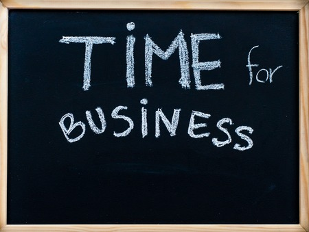 Time for business message handwritten with white chalk on wooden frame blackboard, successful business concept photo