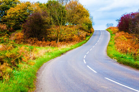 contryside: Autumn contryside road in Yorkshire Dales National Park, United Kingdom Stock Photo