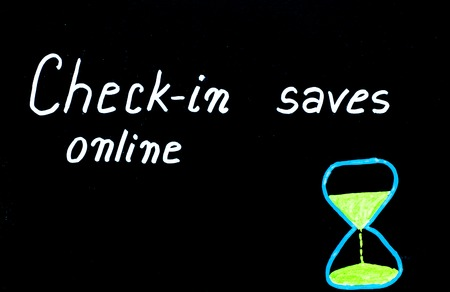 available time: Check-in online saves time message written with white chalk on blackboard, copy space available