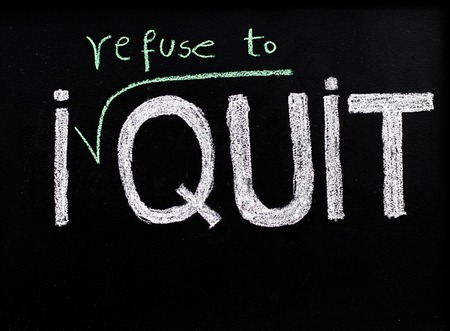 refuse: I refuse to quit message, handwriting with chalk on blackboard, lifestyle change concept Stock Photo