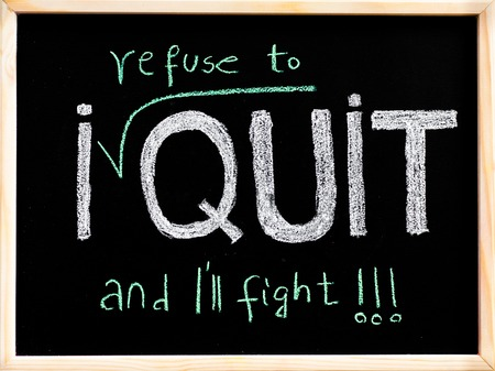 refuse: I refuse to quit message, handwriting with chalk on wooden frame blackboard, lifestyle change concept