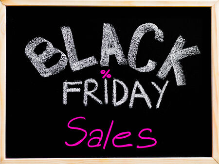 biggest: Black Friday sales advertisement handwritten with chalk on wooden frame blackboard, Black Friday sale concept Stock Photo