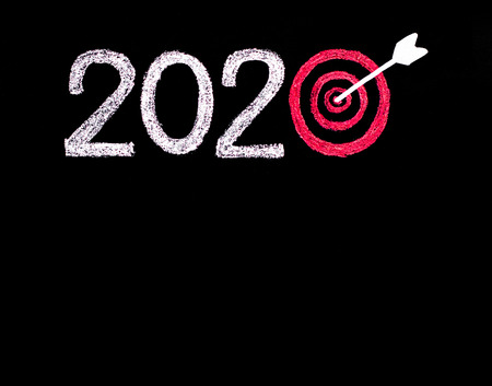 long term goal: Conceptual image of Year 2020, with number zero in shape of a target and arrow in the center. Stock Photo