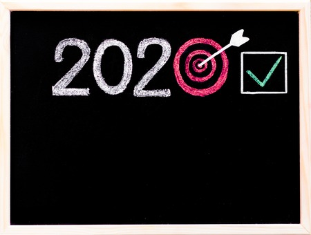 long term goal: Conceptual image of Year 2020, with number zero in shape of a target, arrow in the center and checked sign Stock Photo