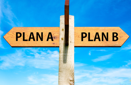 plan b: Wooden signpost with two opposite arrows over clear blue sky, Plan A and Plan B, Right choice conceptual image