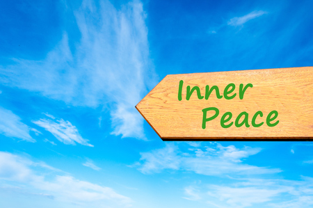 inner peace: Wood arrow sign against clear blue sky with Inner Peace message