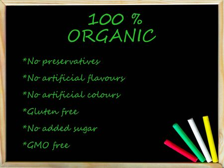preservatives: 100% organic, vintage chalk text on blackboard, colored chalk in the corner, Healthy Lifestyle conceptual image Stock Photo