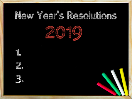 New Years Resolutions 2019, vintage chalk text on blackboard, colored chalk in the corner, Business Vision conceptual image Stock Photo