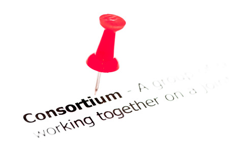 collectives: Word Consortium pinned on white paper with red pushpin, copy space available, Business Concept