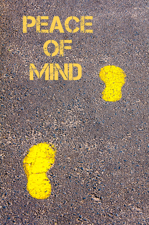 Yellow footsteps on sidewalk towards Peace of Mind message, Serenity conceptual image Фото со стока
