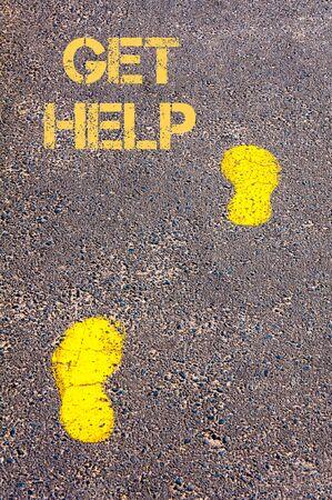 get help: Yellow footsteps on sidewalk towards Get Help message.Conceptual image