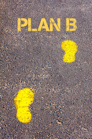 plan b: Yellow footsteps on sidewalk towards Plan B message.Conceptual image