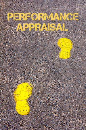 performance appraisal: Yellow footsteps on sidewalk towards Performance Appraisal message.Conceptual image Stock Photo