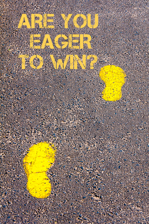 eager: Yellow footsteps on sidewalk towards Are you eager to win message.Conceptual image