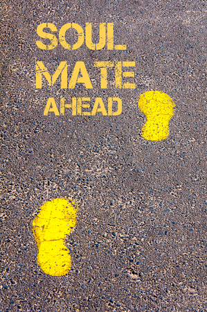 soul mate: Yellow footsteps on sidewalk towards Soul Mate Ahead message.Conceptual image Stock Photo