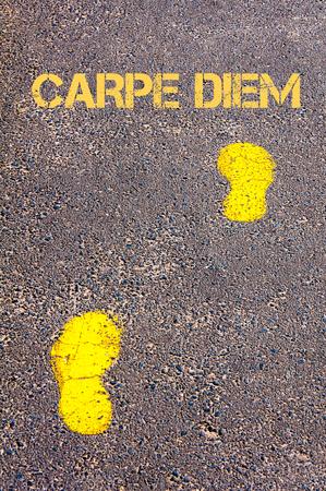 carpe diem: Yellow footsteps on sidewalk towards Carpe Diem message.Conceptual image