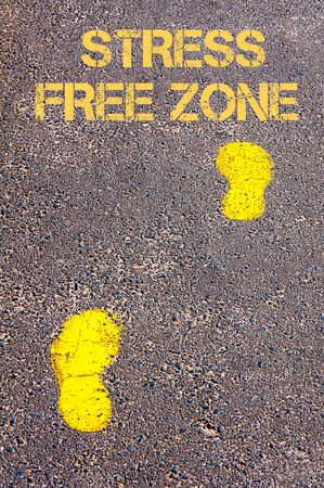 stress free: Yellow footsteps on sidewalk towards Stress Free Zone message.Conceptual image