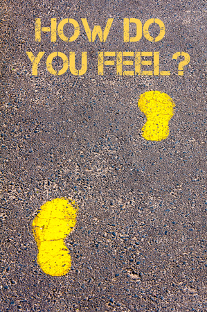 by feel: Yellow footsteps on sidewalk towards How Do You Feel message.Concept image Stock Photo