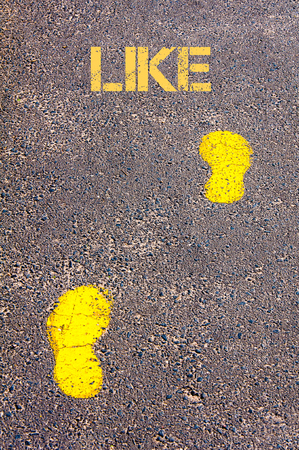 Yellow footsteps on sidewalk towards Like message.Conceptual image