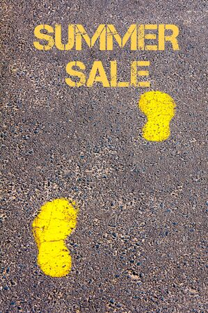 sidewalk sale: Yellow footsteps on sidewalk towards Summer Sale message.Conceptual image Stock Photo