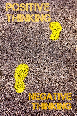 negative thinking: Yellow footsteps on sidewalk from Negative Thinking to Positive Thinking message. Conceptual image