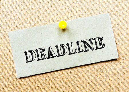 billboard posting: Recycled paper note pinned on cork board. Deadline message. Concept Image