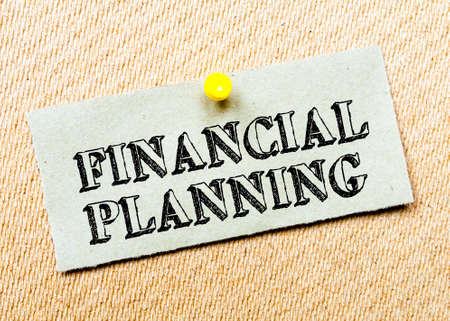 billboard posting: Recycled paper note pinned on cork board. Financial Planning Message. Concept Image