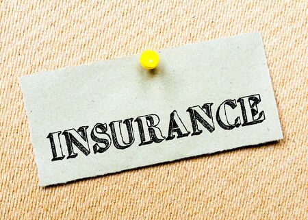 billboard posting: Recycled paper note pinned on cork board. Insurance Message. Concept Image