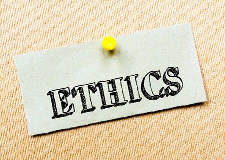 billboard posting: Recycled paper note pinned on cork board. Ethics Message. Concept Image