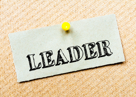 billboard posting: Recycled paper note pinned on cork board. Leader Message. Concept Image