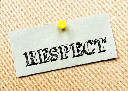 billboard posting: Recycled paper note pinned on cork board. Respect Message. Concept Image