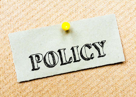 billboard posting: Recycled paper note pinned on cork board.Policy  Message. Concept Image