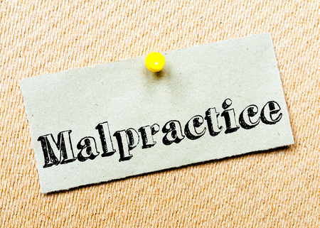 malpractice: Recycled paper note pinned on cork board. Malpractice Message. Concept Image