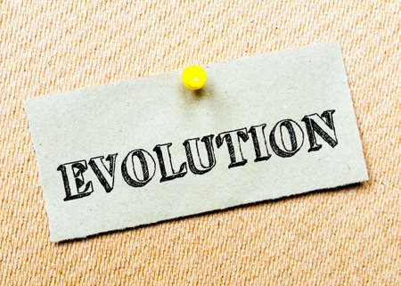billboard posting: Recycled paper note pinned on cork board.Evolution Message. Concept Image Stock Photo
