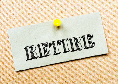 retire: Recycled paper note pinned on cork board. Retire Message. Concept Image Stock Photo