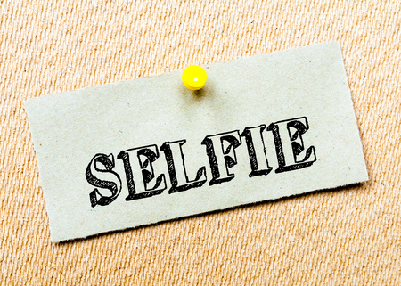 billboard posting: Recycled paper note pinned on cork board. Selfie Message. Concept Image