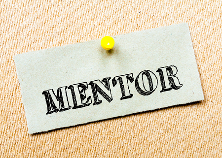 billboard posting: Recycled paper note pinned on cork board. Mentor Message. Concept Image