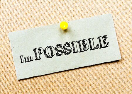 billboard posting: Recycled paper note pinned on cork board. Impossible Message. Concept Image Stock Photo