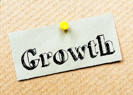 billboard posting: Recycled paper note pinned on cork board. Growth Message. Concept Image