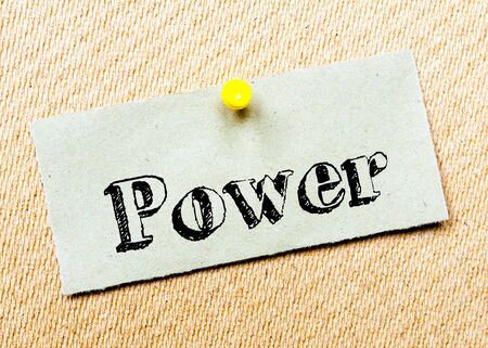 billboard posting: Recycled paper note pinned on cork board. Power Message. Concept Image