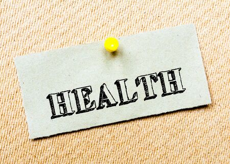 billboard posting: Recycled paper note pinned on cork board. Health Message. Concept Image