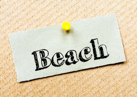 billboard posting: Recycled paper note pinned on cork board. Beach Message. Concept Image