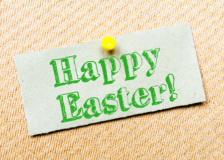 billboard posting: Recycled paper note pinned on cork board. Happy Easter Message. Concept Image