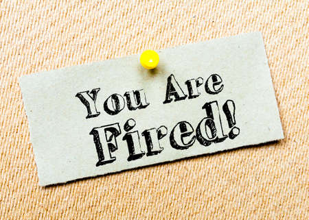 you are fired: Recycled paper note pinned on cork board. You are Fired Message. Concept Image