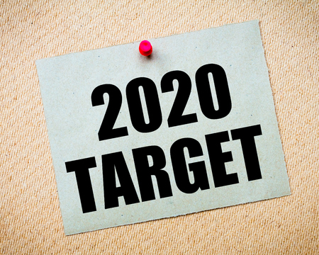 billboard posting: Recycled paper note pinned on cork board. 2020 Target Message. Concept Image Stock Photo