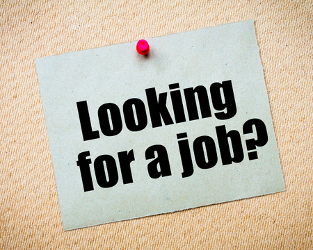 billboard posting: Recycled paper note pinned on cork board. Looking for a Job Message. Concept Image Stock Photo