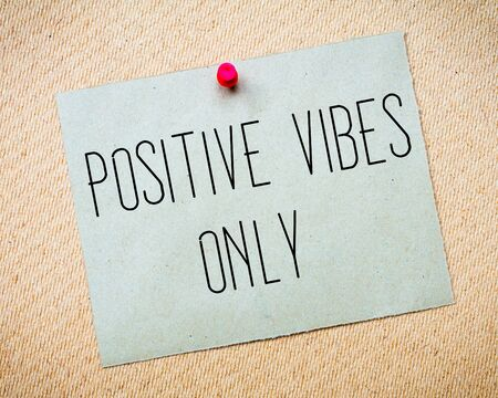 vibes: Recycled paper note pinned on cork board. Positive Vibes Only Message. Concept Image Stock Photo