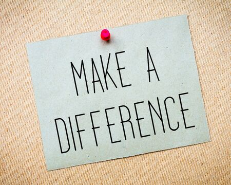 billboard posting: Recycled paper note pinned on cork board. Make a Difference Message. Concept Image