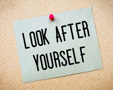 look after: Recycled paper note pinned on cork board. Look After Yourself Message. Concept Image Stock Photo
